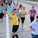 Utah Valley Marathon guy in yellow celebrating